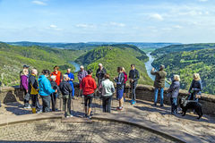 Saar loop at Cloef, a famous viewpoint. CLOEF, GERMANY - APRIL 29, 2013: people enjoy the spectacular view to the Saar loop at Cloef, Germany. The scenic spot Stock Photo