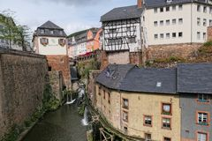 Cityscape of Saarburg with its historical old town part and Leuk River flowing into the city towards the ancient mills. royalty free stock photography