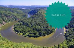 Saarschleife of the Saar near Orscholz with the inscription star in green Saarland with a view of the entire Saarbiegung in Saar-L royalty free stock image