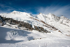 Saas Fee mountain range. Scenic view from Mittelallalin of mountain peaks (Alphubel, Dom, Taeschorn) at Saas Fee in winter, Switzerland stock photos