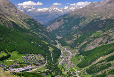 Saas Fee and Saas Grund, Switzerland. View of Valley Saastal in the canton Wallis , in the foreground the town of Saas Fee and Saas Grund, Switzerland stock photos