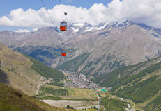Saas Fee town with cable car. Alpine town of Saas Fee in Saas valley surrounded by high mountains, connected by cable car, Valais, Switzerland royalty free stock images
