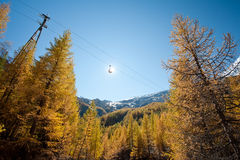 Saas Fee vilage - cabin lift above autumn forest Stock Images