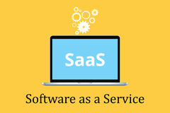 Saas software as a service concept with laptop and poster text  gear icon Stock Photography