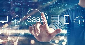 SaaS - software as a service concept with a man on city background