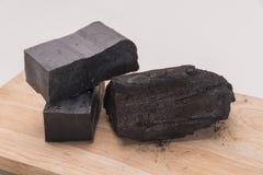 Sabão do carbono e uma pilha do carvão Imagens de Stock