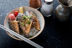 Saba  fish grill with teriyaki sauce on rice. Stock Photo