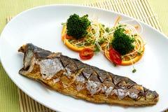 Saba Fish Steak. With slice orange Stock Photo
