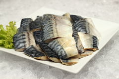 Saba fish on a white plate Royalty Free Stock Photo