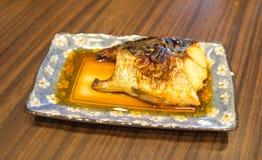 Saba fish on wooden background.  Stock Image