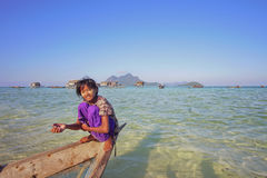 SABAH, MALAYSIA - APR 19: Unidentified Bajau Laut kids on a boat Royalty Free Stock Image