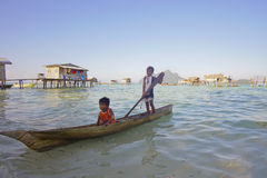 SABAH, MALAYSIA - APR 19: Unidentified Bajau Laut kids on a boat Stock Photography