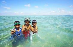 SABAH, MALAYSIA - NOVEMBER 19: Unidentified Bajau Laut kids hold a beautiful starfish at Maiga Island on November 19, 2015. Royalty Free Stock Images