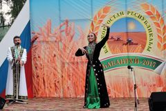 Sabantui celebration in Moscow. Dancer woman on stage royalty free stock photography