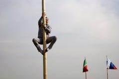 Sabantui celebration in Moscow. A man climbs a pillar royalty free stock photo