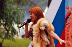 Sabantui celebration in Moscow. Singer woman on stage stock image
