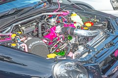 Sabaru engine on show at Motor Mania. Colorful high power engine on Sabaru saloon car shown at Grantown on Spey Motor Mania event held on 3rd September 2017 stock photo