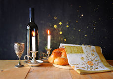 Sabbath image. challah bread and candelas on wooden table Stock Photography
