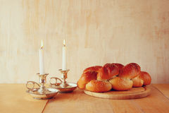 Sabbath image. challah bread and candelas on wooden table.  Royalty Free Stock Photography