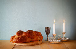 Sabbath image. challah bread and candelas on wooden table.  Stock Images