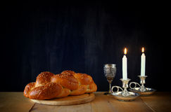 Sabbath image. challah bread and candelas on wooden table.  Royalty Free Stock Image