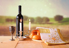 Sabbath image. challah bread and candelas on wooden table.  Royalty Free Stock Images
