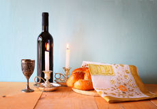 Sabbath image. challah bread and candelas on wooden table.  Stock Photo