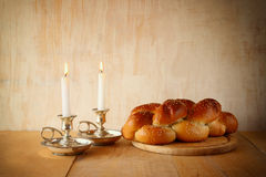 Sabbath image. challah bread and candelas on wooden table.  Stock Photos