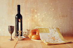 Sabbath image. challah bread and candelas on wooden table. glitter overlay.  Royalty Free Stock Image