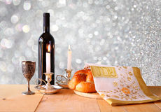 Sabbath image. challah bread and candelas on wooden table. glitter overlay.  Stock Image
