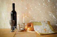 Sabbath image. challah bread and candelas on wooden table. glitter overlay Stock Image