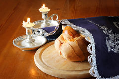Sabbath image. challah bread and candelas on wooden table Royalty Free Stock Image
