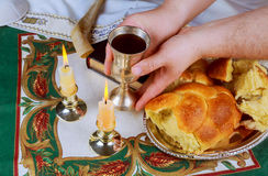 Sabbath image. challah bread, sabbath wine and candelas on wooden table. Glitter overlay Royalty Free Stock Images