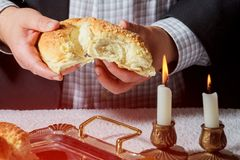 Sabbath kiddush ceremony composition with two candles and a traditional sweet fresh challah bread. Sabbath kiddush ceremony composition with two wax candles in Royalty Free Stock Photo