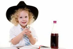 Sabbath ritual. Portrait of an adorable curly haired blond little three year old boy wearing white shirt and tie and a black fedora practicing the Jewish Sabbath Royalty Free Stock Photography