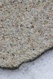Sabbia con le piccole rocce fotografia stock libera da diritti