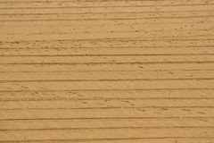 Sabbia con le piste di veicolo Fotografia Stock Libera da Diritti