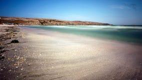 Sabbia confusa e riva della spiaggia coperta coperture Fotografie Stock