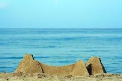 Sabbia del castello sulla spiaggia Immagini Stock