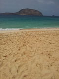 Sabbia della luce di Brown sulla spiaggia Immagini Stock Libere da Diritti
