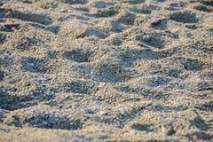 Sabbia della spiaggia al tramonto, fondo Immagine Stock Libera da Diritti