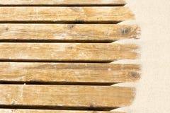 Sabbia delle dune su una pavimentazione di legno Fotografie Stock