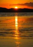 Sabbia di mare e tramonto Fotografie Stock Libere da Diritti