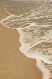 Sabbia di mare ed onda Immagine Stock Libera da Diritti