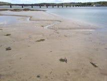 Sabbia e ponte Fotografia Stock