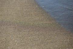 Sabbia e primo piano del mare fotografia stock libera da diritti