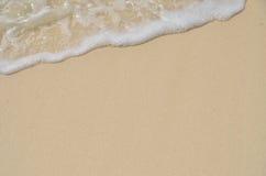 Sabbia e schiuma Immagine Stock