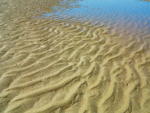Sabbia ed acqua Fotografia Stock
