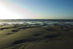 Sabbia ed acqua che fanno le forme Immagine Stock