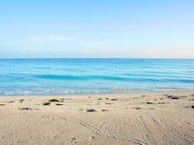 Sabbia ed il mare Fotografia Stock